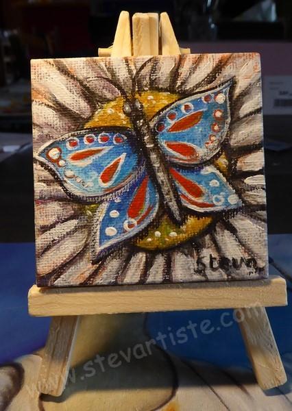 Steva papillon bleu et rouge